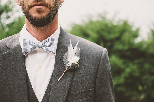 a boutonniere on a man's dress in the right place